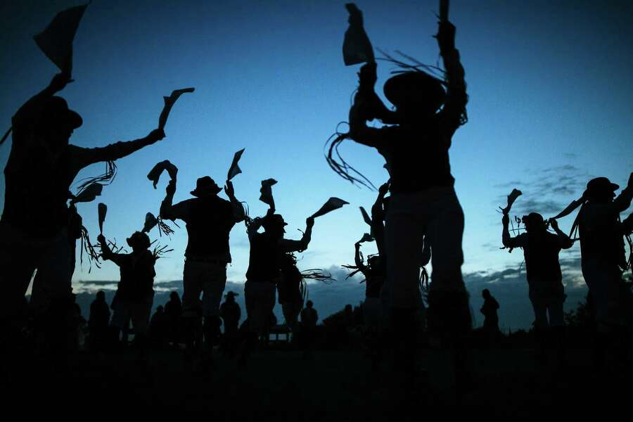 The Berkeley Morris dance company perform before the sunrise on Inspiration Point at Tilden Park in Berkeley on Tuesday, May 1, 2018. Morris dancing is a traditional folk dance from England dating back to the 15th century, Photo: Mason Trinca / Special To The Chronicle / Mason Trinca