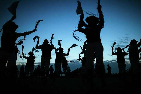The Berkeley Morris dance company perform before the sunrise on Inspiration Point at Tilden Park in Berkeley on Tuesday, May 1, 2018. Morris dancing is a traditional folk dance from England dating back to the 15th century,