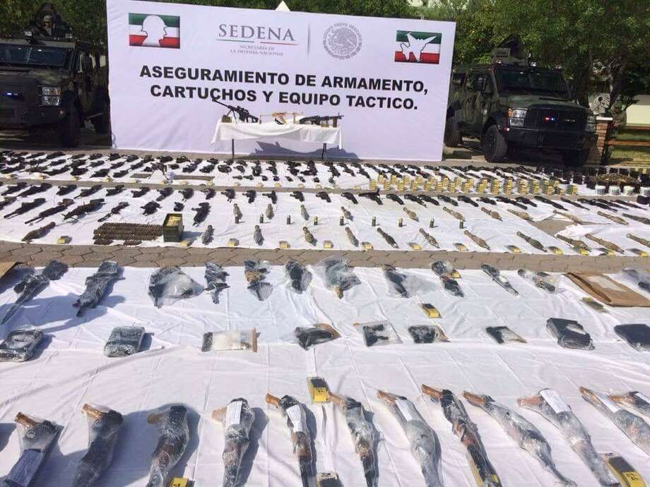 SEDENA soldiers seized 32 assault rifles, 806 magazines, 30,338 rounds of ammo, two grenades and a rocket launcher at home in Nuevo Laredo. Photo: Courtesy Photo