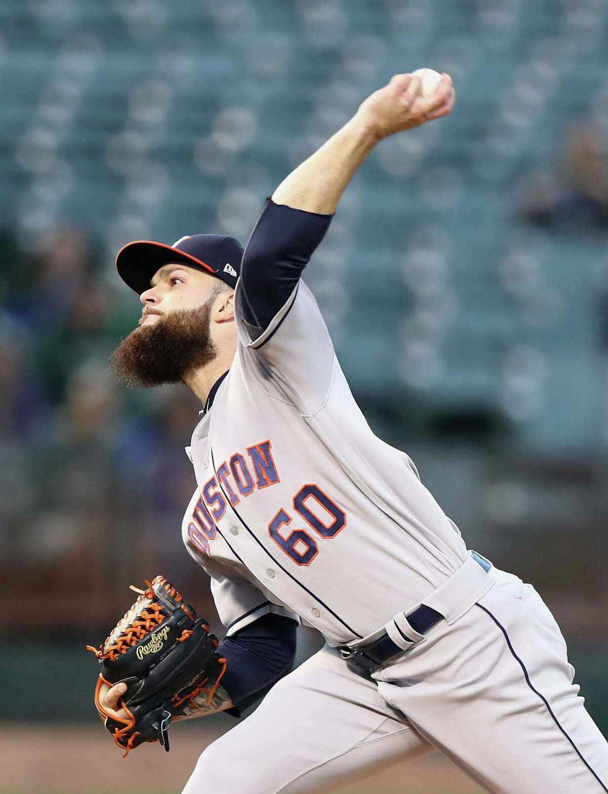 OAKLAND, CA - MAY 07: Dallas Keuchel #60 of the Houston Astros pitches against the Oakland Athletics in the first inning at Oakland Alameda Coliseum on May 7, 2018 in Oakland, California.