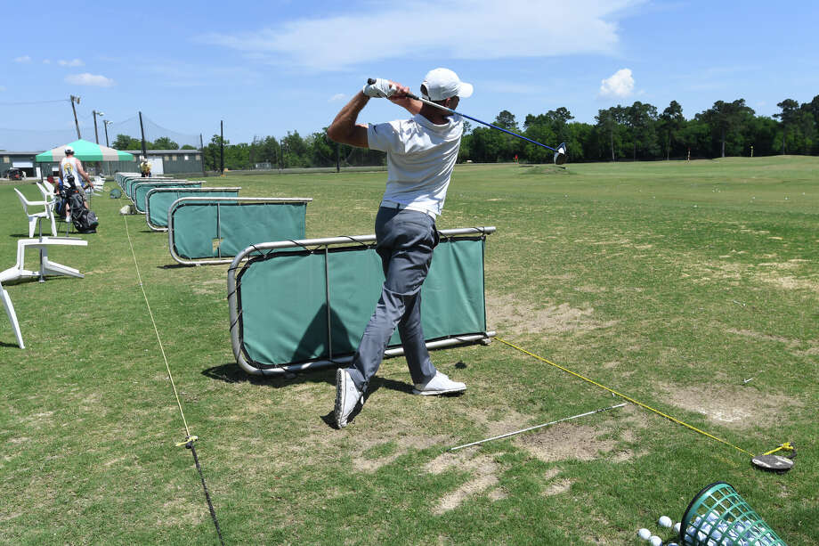 Sydney Merunka practices his swing at 5 Under Golf Center on Monday. Formerly known as Games People Play, 5 Under plans to offer Topgolf-branded features to its clientele.       Photo taken Monday, May 07, 2018 Guiseppe Barranco/The Enterprise Photo: Guiseppe Barranco, Photo Editor / Guiseppe Barranco ©