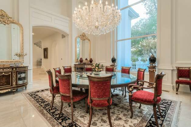 An 18,288-square-foot mansion at 9006 Douglas Ave. is on the market for nearly $13 million. The home comes with eight bedrooms, eight full bathrooms and an 822-square-foot guest house. Photo: Daniel Martinez, Kevin Tally, Allie Beth Allman & Associates