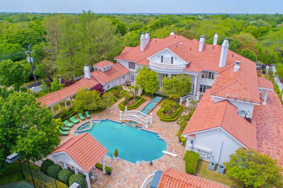 An 18,288 square-foot mansion at 9006 Douglas Ave. is on the market for nearly $13 million. The home comes with eight bedrooms, 8.3 bathrooms and a 822 square-foot guest house.Scroll ahead to see more of the house in the gallery ahead.