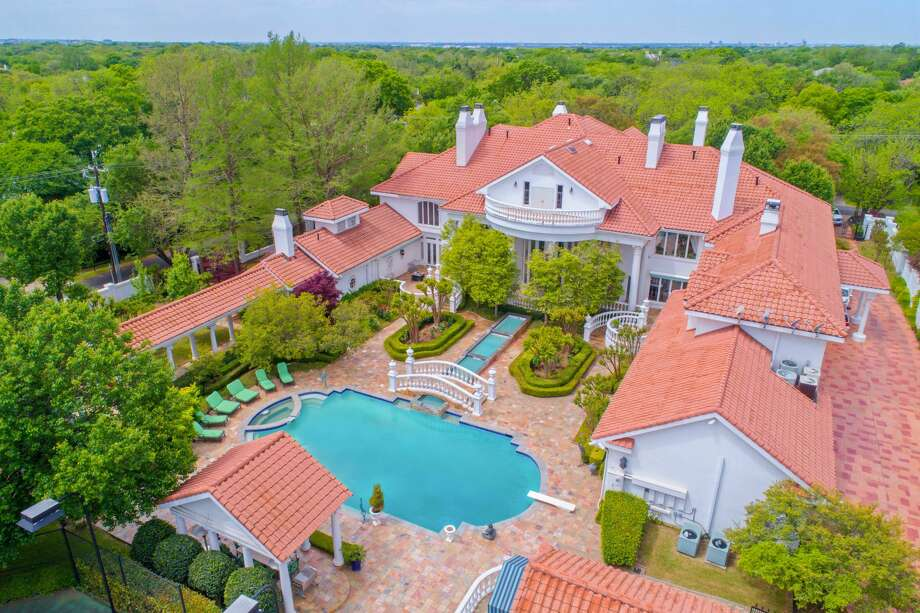 An 18,288 square-foot mansion at 9006 Douglas Ave. is on the market for nearly $13 million. The home comes with eight bedrooms, 8.3 bathrooms and a 822 square-foot guest house.Scroll ahead to see more of the house in the gallery ahead. Photo: Kevin Tally, Allie Beth Allman & Associates