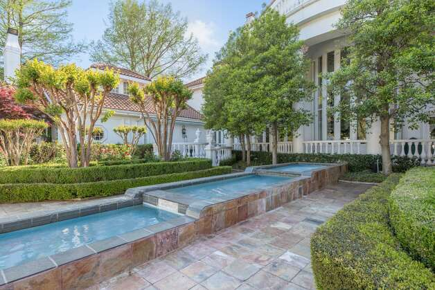 An 18,288-square-foot mansion at 9006 Douglas Ave. is on the market for nearly $13 million. The home comes with eight bedrooms, eight full bathrooms and an 822-square-foot guest house. Photo: Kevin Tally, Allie Beth Allman & Associates