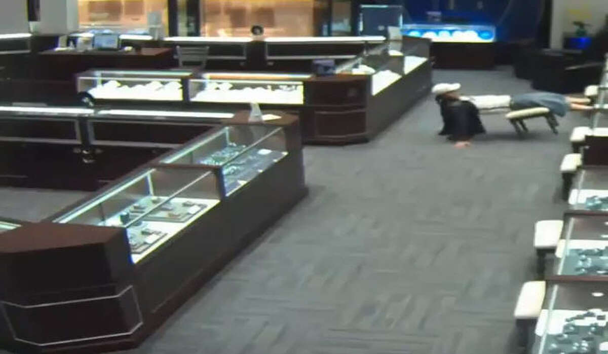 The Houston Police Department robbery unit is asking for the public's help in identifying a man who is accused of aggravated robbery with a deadly weapon at a Galleria jewelry store. In the middle of the alleged crime, the man nearly fell out of his chair.