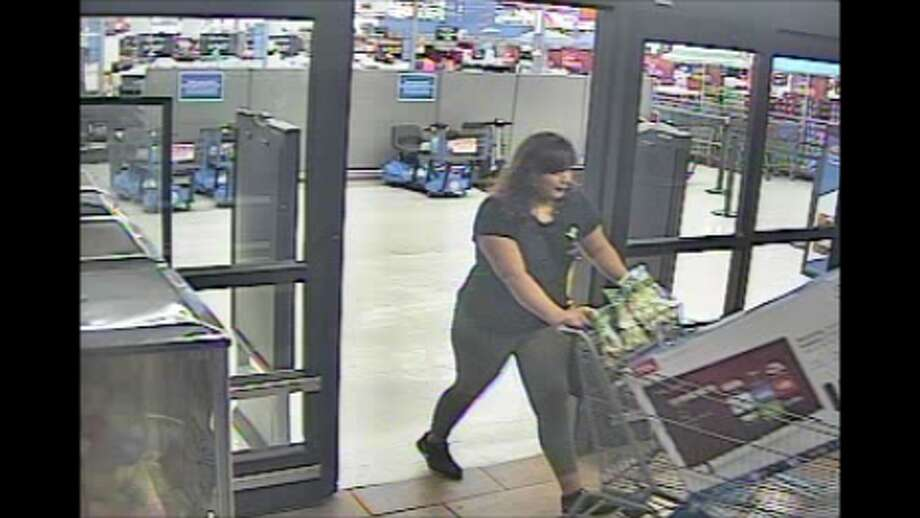 Police are asking for help in identifying a woman who was caught on video leaving store without paying for four TVs. Photo: Laredo Police Department