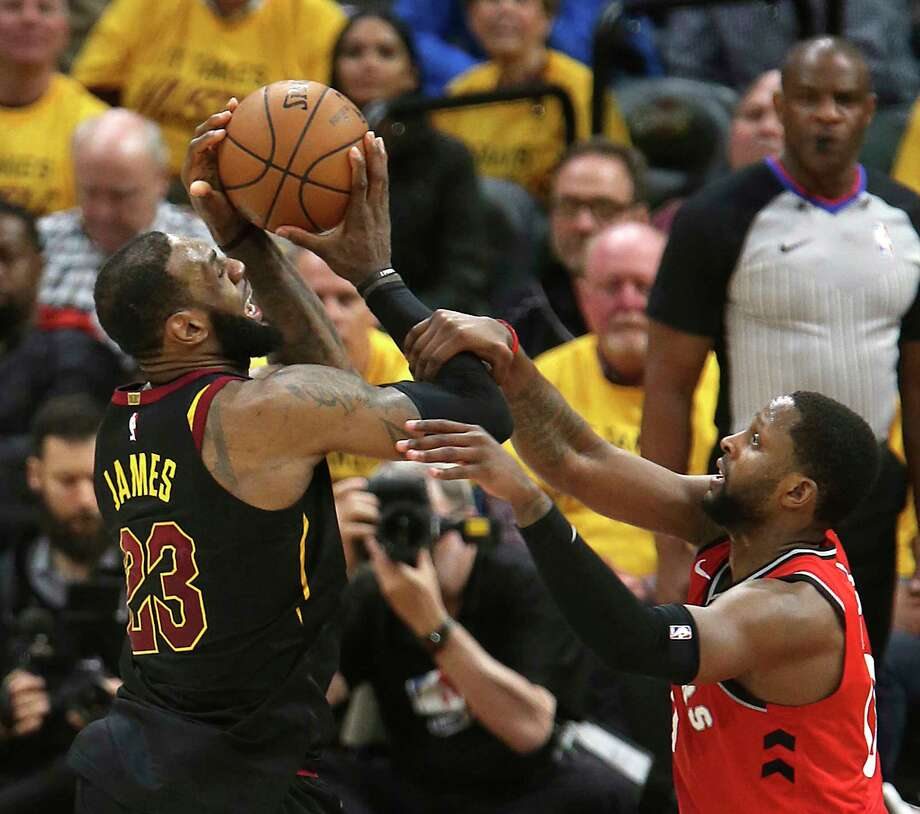 Cleveland Cavaliers' LeBron James is fouled by Toronto Raptors' C.J. Miles in the third quarter of Game 4 of a second-round playoff series on Monday, May 7, 2018 in Cleveland, Ohio. The Cavaliers won the game 128-93 to sweep the series against the Raptors. Photo: PHIL MASTURZO, TNS / Akron Beacon Journal