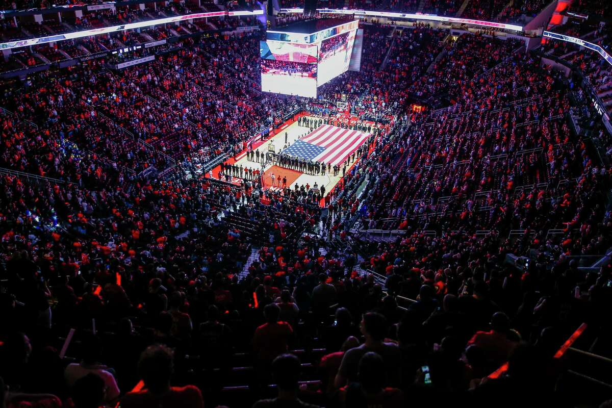 A flag covers the court at the Toyota Center for the national anthem as the Houston Rockets take on the Minnesota Timberwolves in the first game of the NBA playoffs Sunday, April 15, 2018 in Houston.