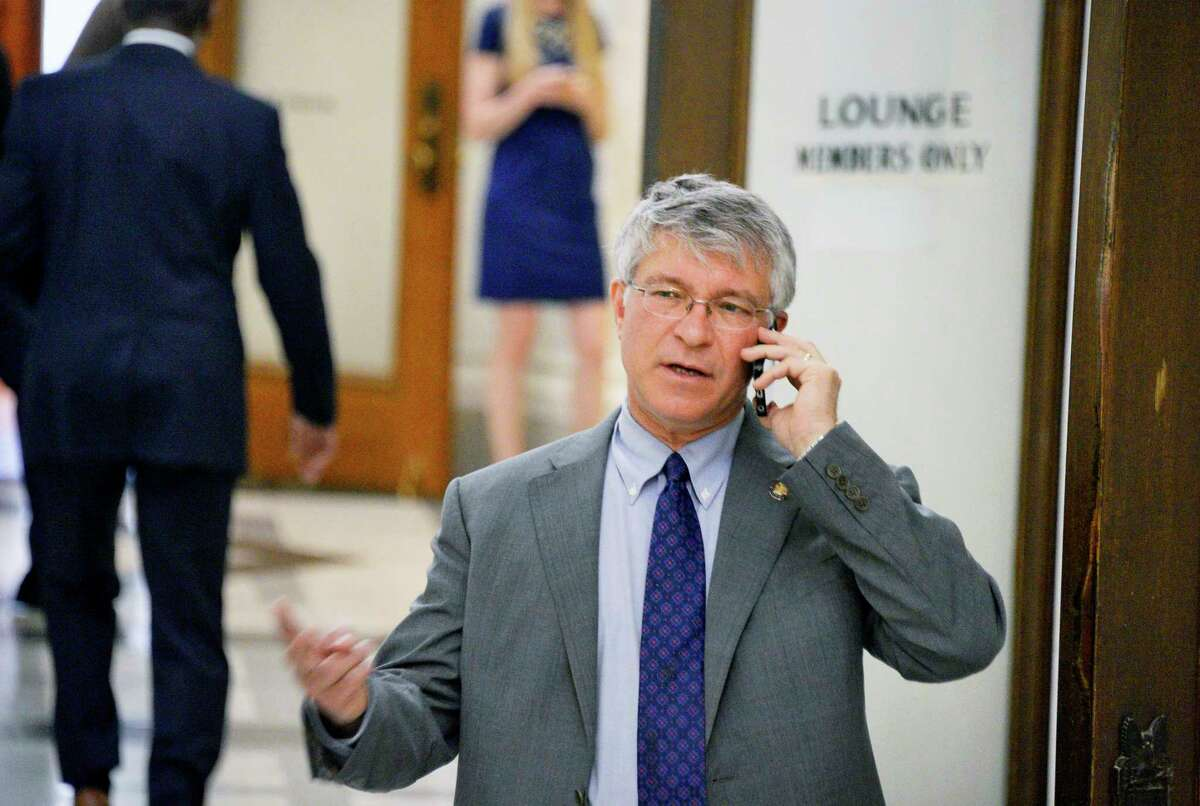 Assemblymember Steck on his cell phone following a conference by Assembly Democrats about the Attorney General appointment at the Capitol Tuesday May 8, 2018 in Albany, NY. (John Carl D'Annibale/Times Union)