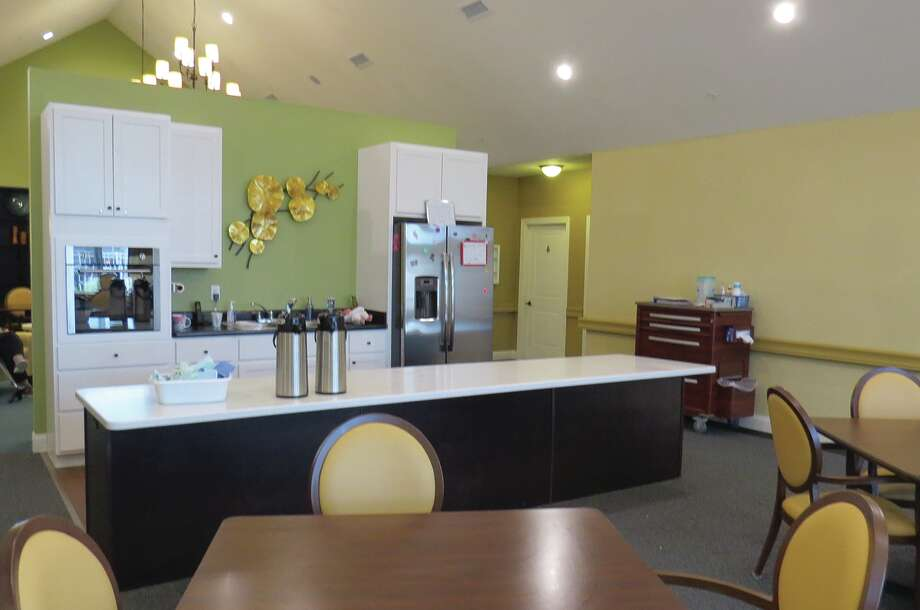 One of the public areaa with a kitchen at San Gabriel Memory Care.