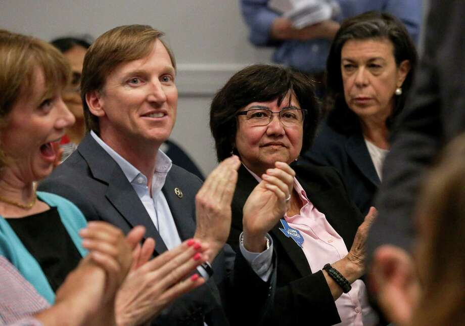 Gubernatorial candidates Andrew White, center-left, and Lupe Valdez, center-right, listen to other speakers at a reception for Democratic run-off candidates April 25 in Houston. White and Valdez have agreed to debate Friday at 7 p.m. at the St. James Episcopal Church in Austin. Photo: Jon Shapley /Houston Chronicle / © 2018 Houston Chronicle