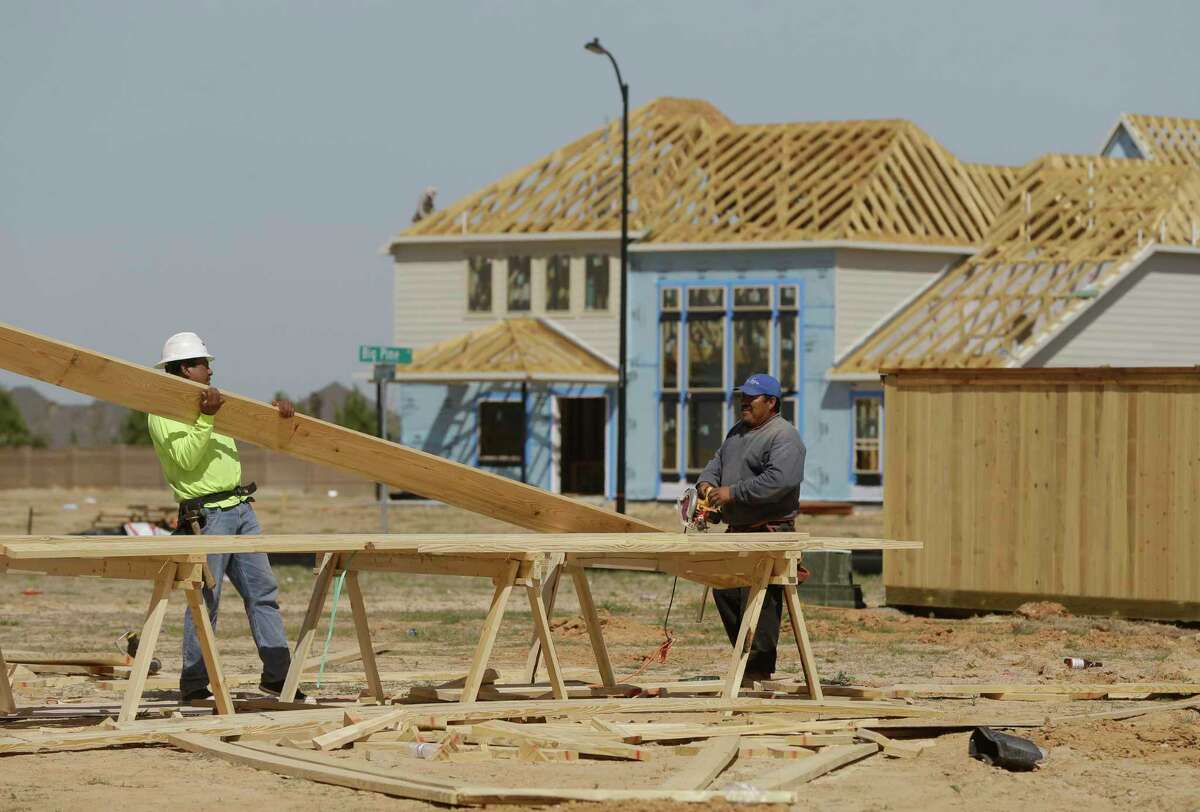 Construction is shown in Parkland Village in the master-planned community of Bridgeland Wednesday, March 21, 2018, in Houston. ( Melissa Phillip / Houston Chronicle )