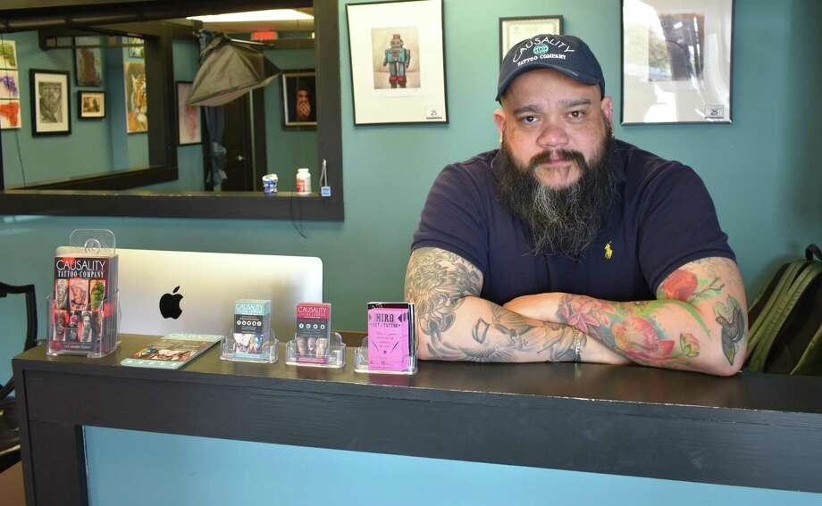 Javier Eastman on May 3, 2018, at his Causality tattoo parlor in Norwalk, Conn. Eastman is starting two new Venezuelan restaurants in June in Norwalk, Avenida on Connecticut Avenue and Calle on North Main Street in South Norwalk. Photo: Alexander Soule / Hearst Connecticut Media / Stamford Advocate