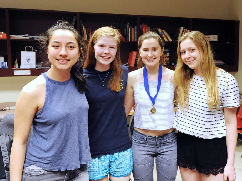 Greenwich High School Innovation Lab seniors from left, Katherine Hurst, Flora Dievenich Braes, Sofia Dodaro and Nicole Wood won first place for their state-level National History Day performance about American scientist and 1983 Nobel Prize award winner Barbara McClintock, and have qualified to participate in the national competition in June. Photo: Bob Luckey Jr. / Hearst Connecticut Media / Greenwich Time
