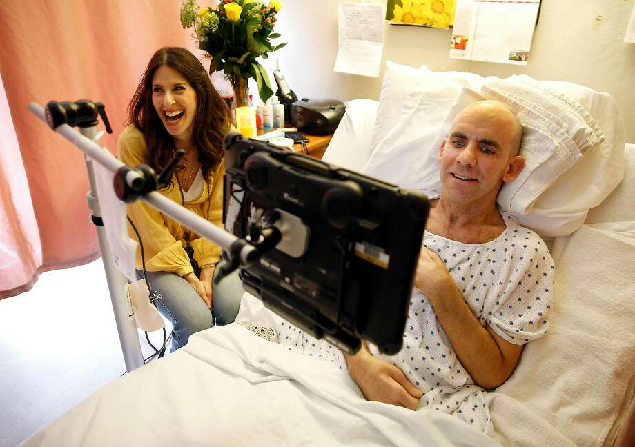 Essence Goldman visits Bernie Dalton at Cupertino Healthcare & Wellness in April. Dalton has given permission for his song's lyrics to be used. Photo: Guy Wathen / The Chronicle