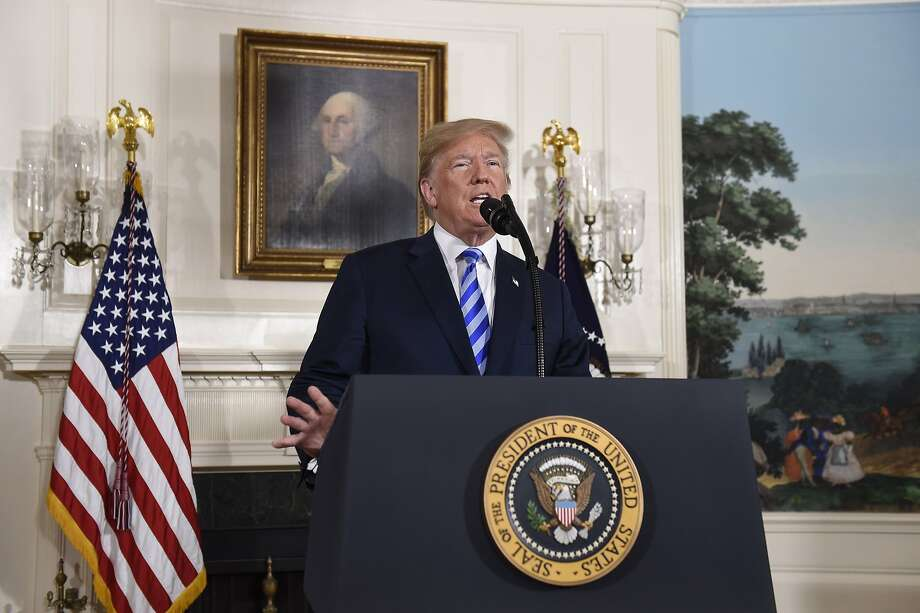 "President Trump said the U.S. ""will be instituting the highest level of economic sanction"" on Iran but allow grace periods for businesses to wind down activity. Photo: Saul Loeb / AFP / Getty Images"
