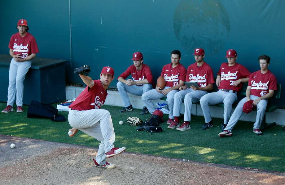 As his teammates look on, Stanford pitcher Kris Bubic throws during practice on Wednesday. Photo: Josie Lepe / Special To The Chronicle