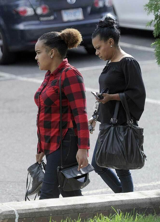 Anny Castillo, 22, who police say abandoned her baby hehind a downtown grocery store in the spring, leaves court Friday, Sept. 15, 2017, with an unidentified woman. Photo: Carol Kaliff / Hearst Connecticut Media / The News-Times