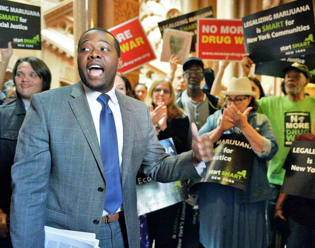 Drug Policy Alliance's Chris Alexander speaks as advocates demand marijuana legalization in New York outside the Senate Chambers at the Capitol Tuesday May 8, 2018 in Albany, NY. (John Carl D'Annibale/Times Union)