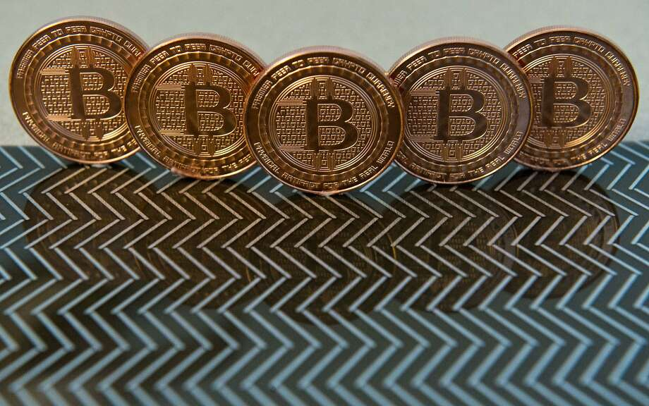 FILE-- This June 17, 2014 file photo photo taken in Washington, DC shows bitcoin medals. The cryptocurrency's 2018 crash may help cement its place in the bubble record books.  Photo: KAREN BLEIER, AFP / Getty Images