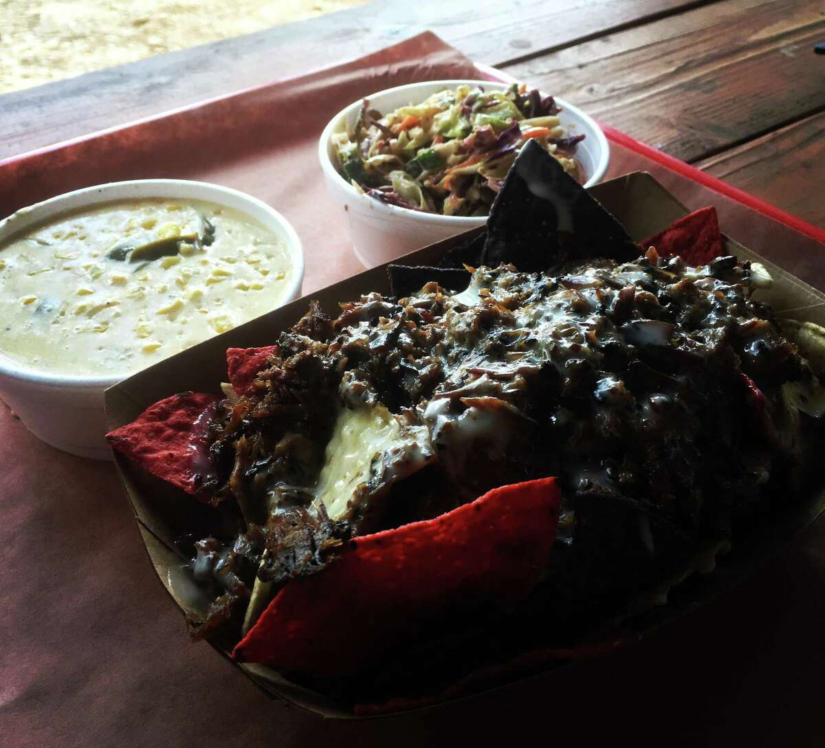 The BBQ nachos ($8) are topped with chopped brisket or pulled pork and layered with a white queso sauce.