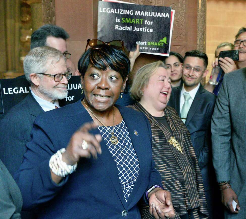 Assemblymember Crystal Peoples-Stokes, center, Assemblymember Richard Gottfried, left, and Senator Liz Krueger join advocates to demand marijuana legalization in New York outside the Senate Chambers at the Capitol Tuesday May 8, 2018 in Albany, NY. (John Carl D'Annibale/Times Union)