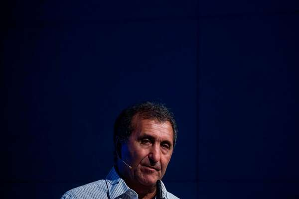 """US former White House photographer Pete Souza addresses guests during the launch of the German edition of his book: """"Obama: An Intimate Portrait"""", in Berlin on April 16. 2018. / AFP PHOTO / John MACDOUGALLJOHN MACDOUGALL/AFP/Getty Images"""