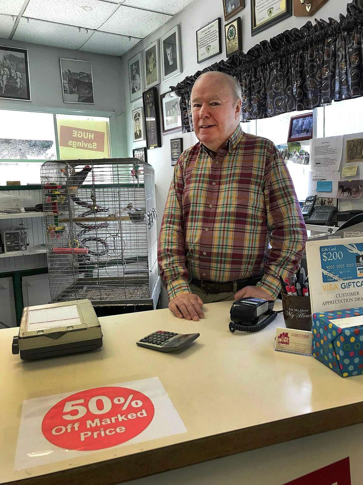 Dan Reilly stands behind the counter at All The Kings's Horses on Ethan Allen Highway in Ridgefield, Conn., on Tuesday, May 8, 2018. Reilly is closing the shop for retirement after 44 years in business.