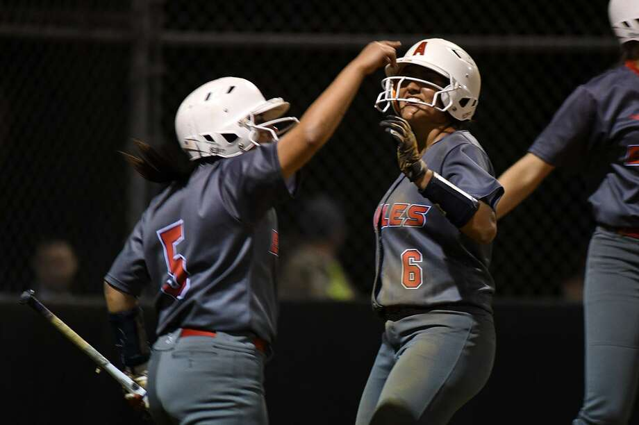 Atascocita senior outfielder Lillie Grotenhuis, center, celebrates with teammate Lesly Miranda (5), a sophomore, after scoring a run against Kingwood and senior pitcher Maddie Lindsey during the top of the 4th inning of their District 21-6A opener at Kingwood Park High School on March 7, 2018. {Photo by Jerry Baker/Freelance) Photo: Jerry Baker, Freelance / For The Chronicle / Freelance