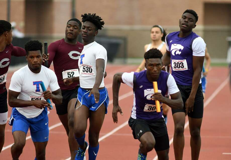Humble's Jordan Booker (300) begins the anchor leg of the Men's 4x400 Meter Relay after taking the baton from teammate Jaden Johnson (303) at the UIL Region III-5A Track Meet at Turner Stadium on April 29, 2017. (Photo by Jerry Baker/Freelance) Photo: Jerry Baker, Freelance / For The Chronicle / Freelance
