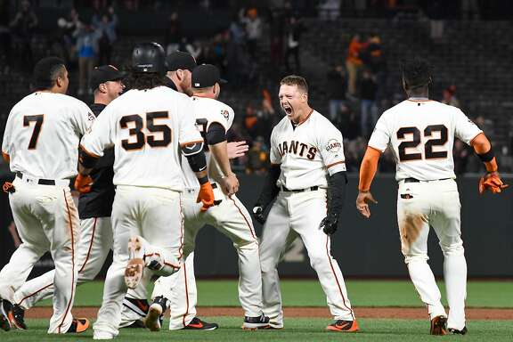 SAN FRANCISCO, CA - APRIL 30:  Nick Hundley #5 of the San Francisco Giants and his teammates celebrates after Hundley hit a pitch-hit walk-off two run rbi single to defeat the San Diego Padres 6-5 in the bottom of the ninth inning at AT&T Park on April 30, 2018 in San Francisco, California.  (Photo by Thearon W. Henderson/Getty Images)