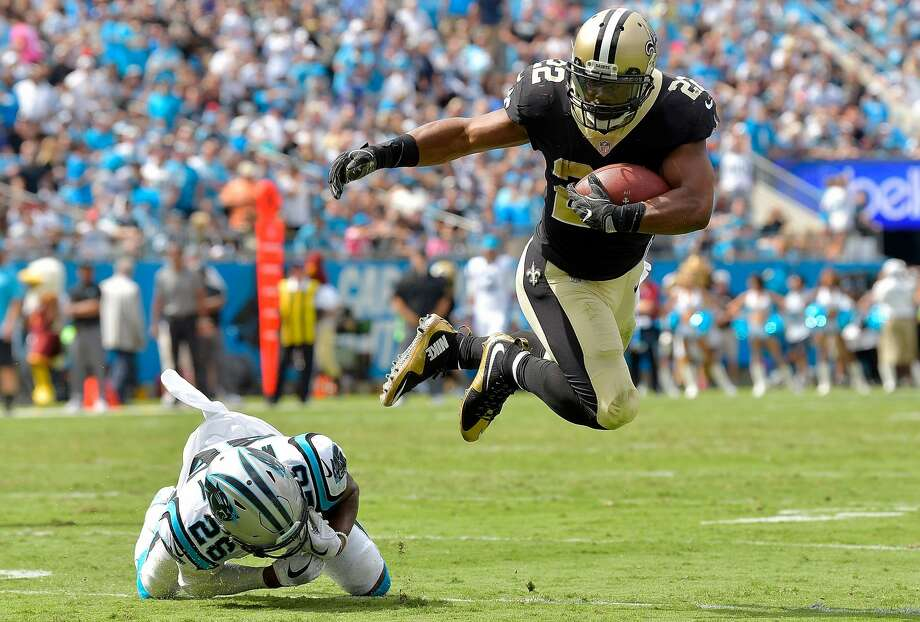 CHARLOTTE, NC - SEPTEMBER 24:  Mark Ingram #22 of the New Orleans Saints hurdles Daryl Worley #26 of the Carolina Panthers during their game at Bank of America Stadium on September 24, 2017 in Charlotte, North Carolina.  (Photo by Grant Halverson/Getty Images) Photo: Grant Halverson/Getty Images