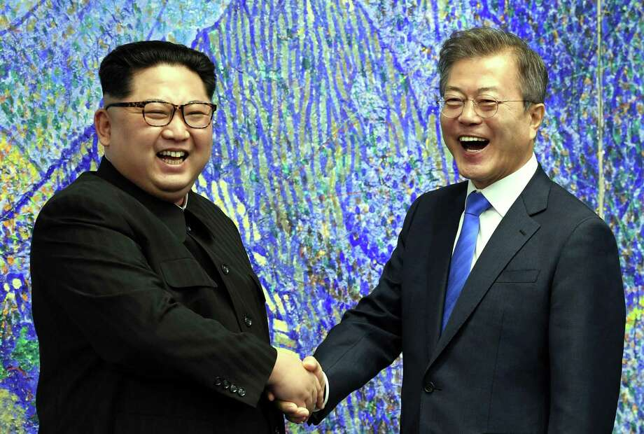 South Korean President Moon Jae-In, right, and North Korean leader Kim Jong-Un before their inter-Korean summit at the Peace House at the south side of the truce village of Panmunjom in the demilitarized zone (DMZ) April 27. The South Korean President's suggestion that Trump could deserve a Nobel Peace Prize is a distraction. Photo: Inter-Korean Summit Press Corps /TNS / Zuma Press