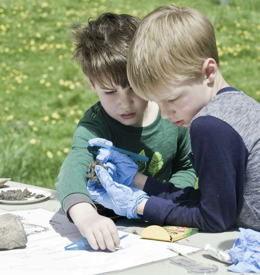 Ethan Hill, 5, and his brother Liam, 7, of Bridgewater, look through owl pellets for bones at Smyrski Farm in New Milford as part of the After School Arts Program in Washington, partnering with Weantinoge Heritage Land Trust. Saturday, May 5, 2018 Photo: Scott Mullin / For Hearst Connecticut Media / The News-Times Freelance
