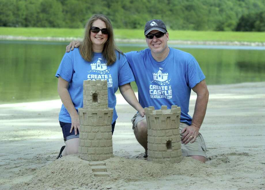 Laurie and Kevin Lane, of New Milford, invented a new system for building sand castles and snow sculptures. Photo: Carol Kaliff / Hearst Connecticut Media / The News-Times