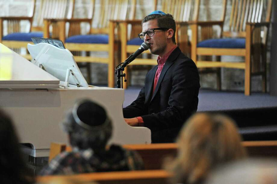 Singer, pianist and composer Gon Halevi performs in celebration of Israel's 70th anniversary inside Temple Sholom on E. Putman Ave. in Greenwich, Conn. on Sunday, May 6, 2018. Photo: Michael Cummo / Hearst Connecticut Media / Stamford Advocate