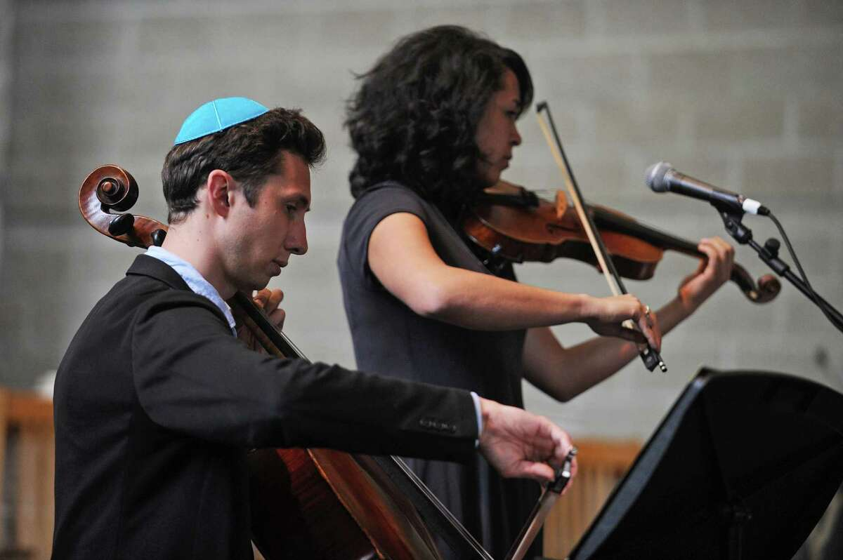 Cellist Julian Muller, left, and violinist (and singer) Zosha Warpeha perform in celebration of Israel's 70th anniversary inside Temple Sholom on E. Putman Ave. in Greenwich, Conn. on Sunday, May 6, 2018.