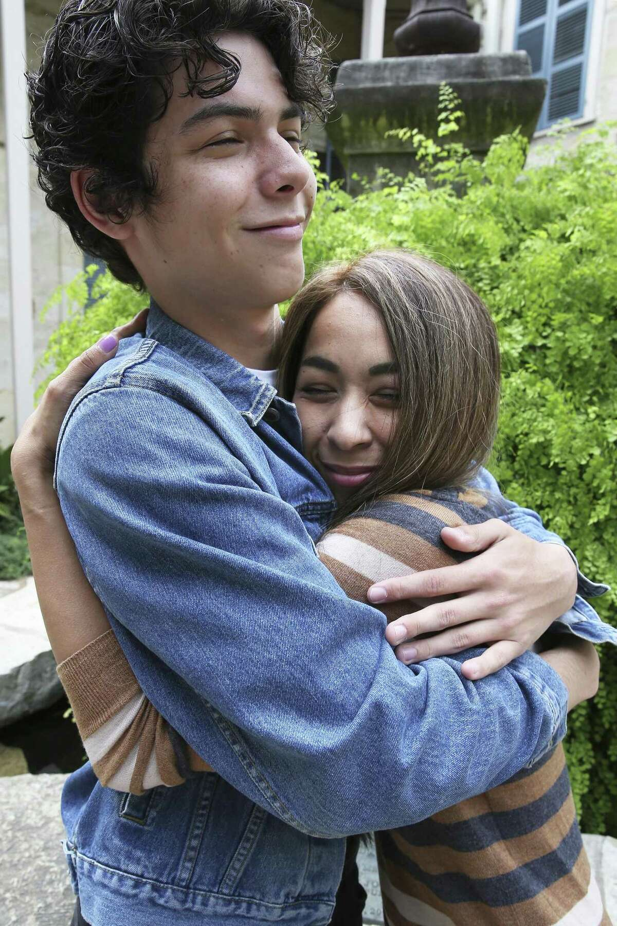 Lauri Garcia Jones shares a hug with her son Charles.