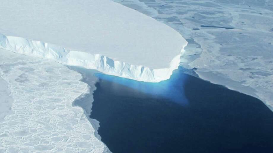This undated handout photo provided by NASA shows the Thwaites Glacier in West Antarctic. Two new studies indicate that part of the huge West Antarctic ice sheet is starting a slow collapse in an unstoppable way. Alarmed scientists say that means even more sea level rise than they figured. (AP Photo/NASA) Photo: Associated Press / NASA