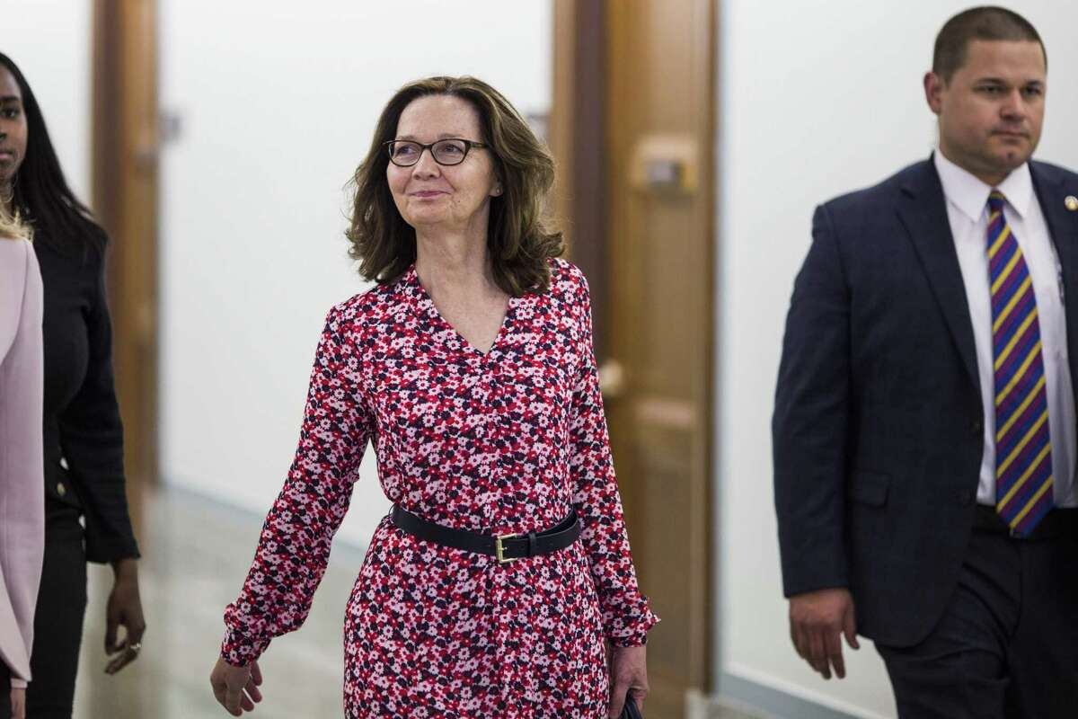 Gina Haspel, director of the Central Intelligence Agency nominee for President Donald Trump, center, walks to a meeting with senators on Capitol Hill on Monday. Trump defended Haspel, his choice to head the CIA, tweeting she has