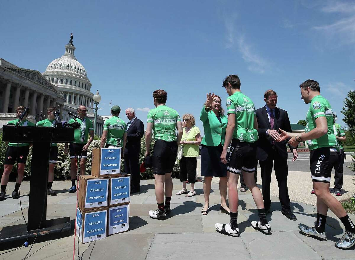 Rep. Elizabeth Esty, D-Conn. and Sen. Richard Blumenthal, D-Conn. congratulate members of Team 26 after they arrived at the U.S. Capitol on the completion of its Sandy Hook bike ride, in honor of the 26 people students and teachers killed at Sandy Hook Elementary School in 2012, on May 8, 2018 in Washington, DC. Team 26 delivered a message to Congress from more than 250,000 Americans in support of common sense measures to reduce gun violence.