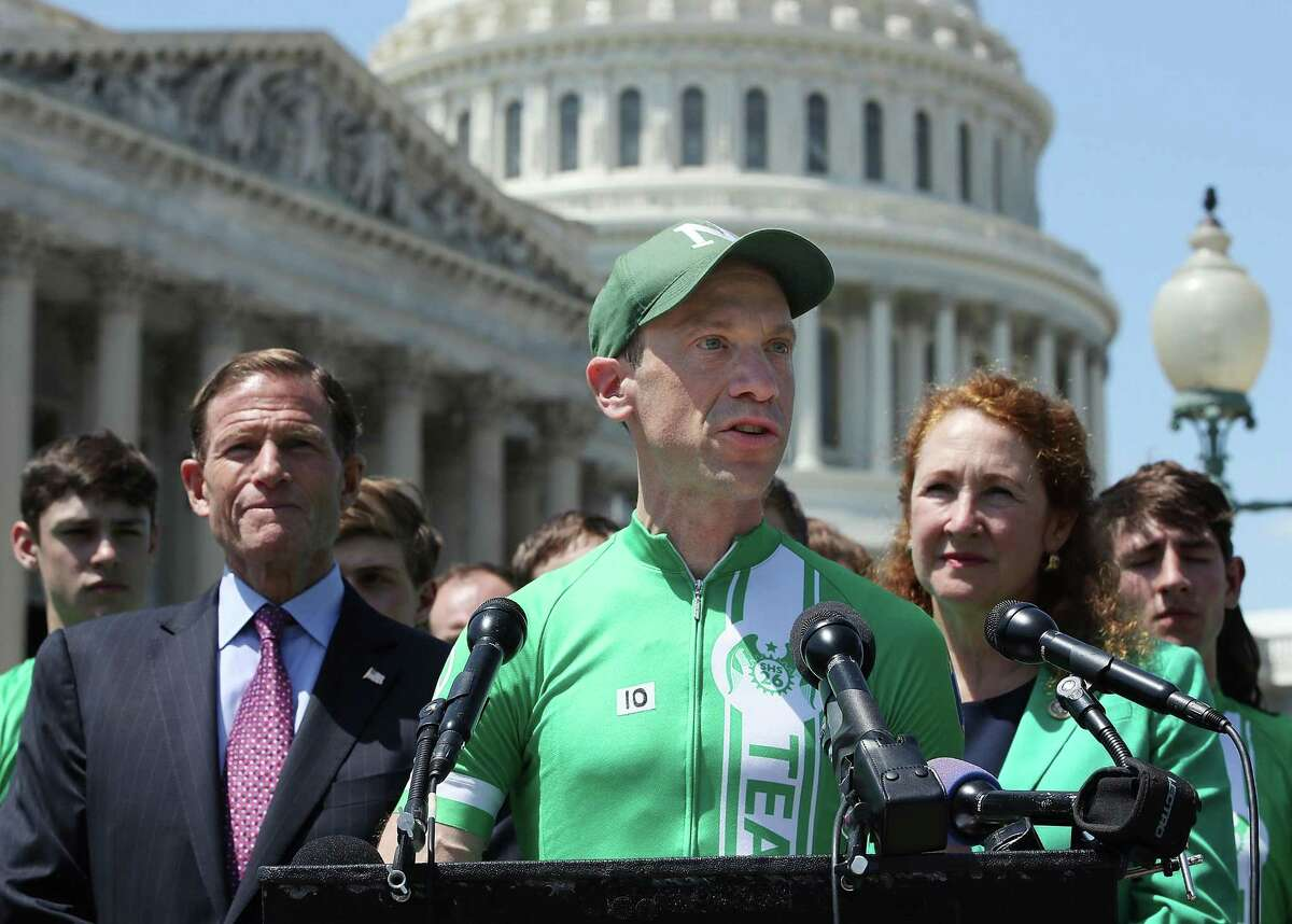 Monte Frank speaks while flanked by Sen. Richard Blumenthal, D-Conn and Rep. Elizabeth Esty, D-Conn. after members of Team 26 arrived at the U.S. Capitol on the completion of its Sandy Hook bike ride, in honor of the 26 people students and teachers killed at Sandy Hook Elementary School in 2012, on May 8, 2018 in Washington, DC. Team 26 delivered a message to Congress from more than 250,000 Americans in support of common sense measures to reduce gun violence.