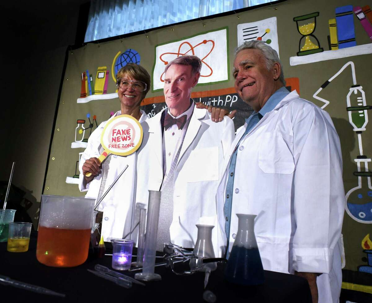 """Carolyn Chipman Evans, left, and her husband, Brent Evans, pose for a picture with a cardboard cutout of Bill Nye, popularly known as """"the science guy,"""" before attending the Planned Parenthood South Texas fundraising luncheon Tuesday. Nye was the featured speaker."""