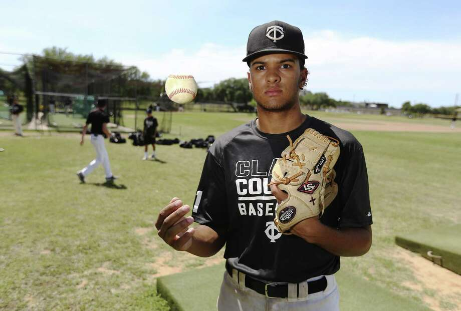 Clark sophomore Jakub Rayfield is the Cougars' top pitcher, leadoff hitter and defensive anchor. Photo: Kin Man Hui / San Antonio Express-News / ©2018 San Antonio Express-News