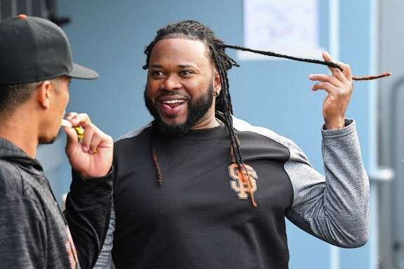 San Francisco Giants Starting pitcher Johnny Cueto (47) jokes with San Francisco Giants Outfield Gorkys Hernandez (7) in the dugout during a MLB game between the San Francisco Giants and the Los Angeles Dodgers on April 1, 2018 at Dodger Stadium in Los Angeles, CA.