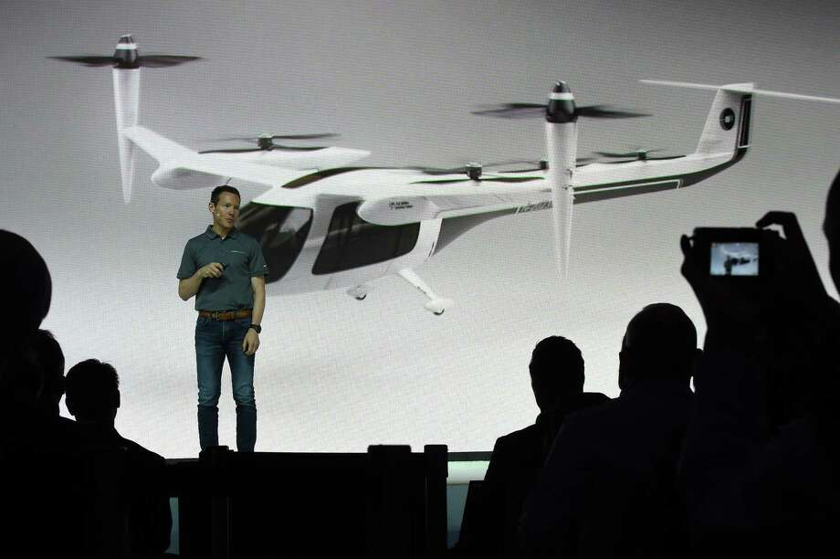 "Jeff Holden, Uber chief product officer, speaks at the second annual Uber Elevate Summit, on May 8, 2018 at the Skirball Center in Los Angeles, California.  Uber introduced it's electric powered ""flying taxi"" vertical take-off and landing concept aircraft at the event, which showcases prototypes for UberAir's fleet of airborne taxis. / AFP PHOTO / Robyn BeckROBYN BECK/AFP/Getty Images Photo: ROBYN BECK, AFP/Getty Images / AFP or licensors"