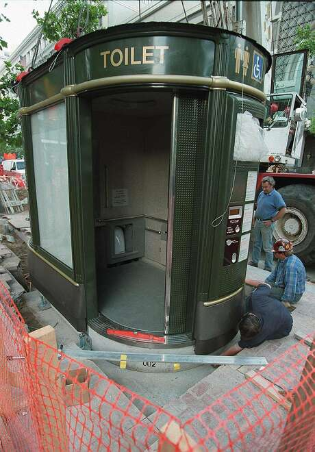 Workers install a new toilet at Powell and Market streets. Photo: Michael Macor / The Chronicle 1995