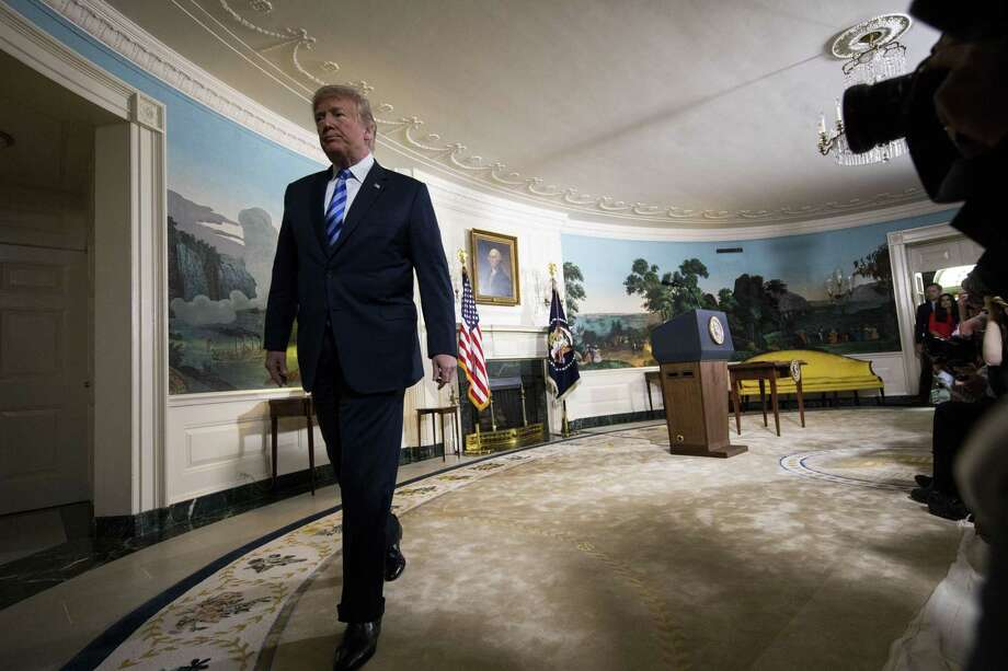 President Donald Trump leaves after  announcing that he is pulling out of the Iran nuclear deal in the Diplomatic Room of the White House in Washington, May 8, 2018. President Trump declared on Tuesday that he was pulling out of the deal, unraveling the signature foreign policy achievement of his predecessor, Barack Obama, and isolating the United States among its Western allies. (Doug Mills/The New York Times) Photo: DOUG MILLS, STF / NYT / NYTNS