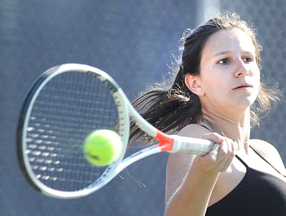 Martine Fierro of Greenwich hits in her match against Cat Sullivan of Danbury during the girls high school tennis between Greenwich High School and Danbury High School at Greenwich, Conn., Tuesday, May 8, 2018. Photo: Bob Luckey Jr. / Hearst Connecticut Media / Greenwich Time